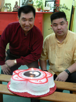 Grandmaster and Tai Sifu pose with the cake for GM's 60th birthday celebration